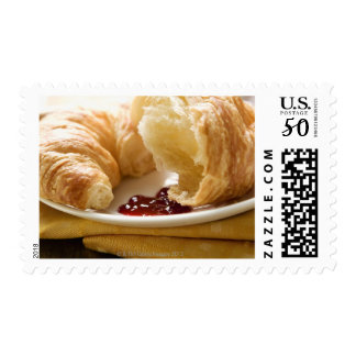 Croissant with jam on a plate postage