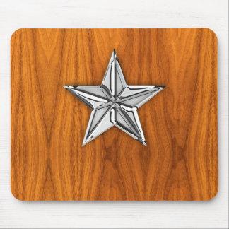 Cromo de plata como la estrella náutica en la mousepad