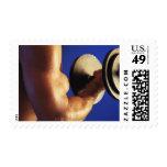 Cropped shot of man lifting weights stamp