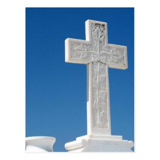 Cross against a blue sky postcard