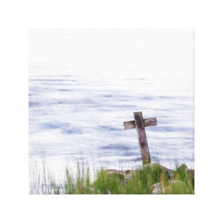 Cross by river canvas print