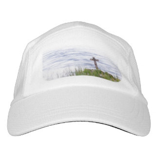 Cross by river hat