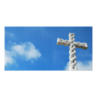 Cross in clouds and blue sky photo card