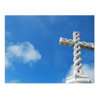 Cross in clouds and blue sky postcard