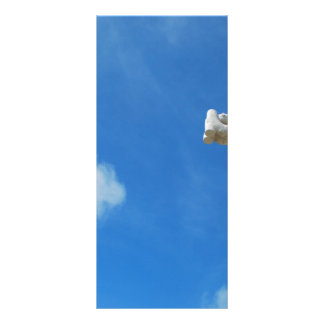 Cross in clouds and blue sky rack card