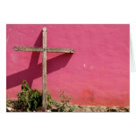 cross leaning on pink wall card