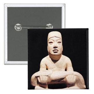 Cross-legged figure holding a baby, Olmec Button
