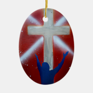Cross, red sky, blue figure with arms raised Double-Sided oval ceramic christmas ornament