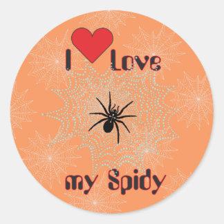 Cross spider in the net classic round sticker