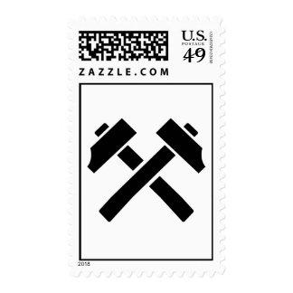 Crossed black hammer postage