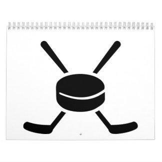 Crossed hockey sticks puck calendar