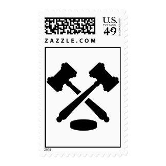Crossed judge hammers postage stamp