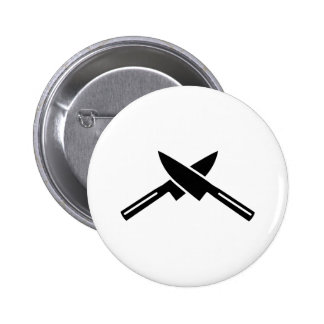 Crossed knives button