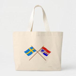 Crossed Sweden and Örebro län flags Canvas Bags