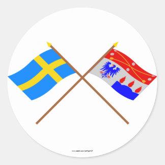 Crossed Sweden and Örebro län flags Round Stickers