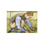 Crouching boy with sickle canvas prints