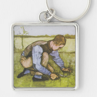 Crouching boy with sickle keychains