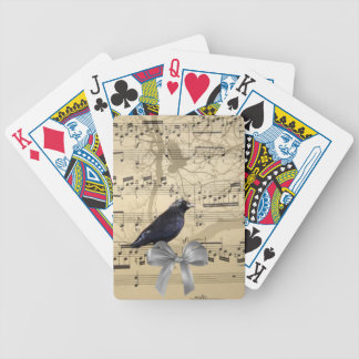 Crow on a music sheet bicycle playing cards