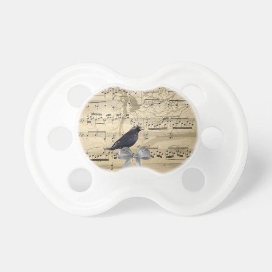 Crow on a music sheet pacifier