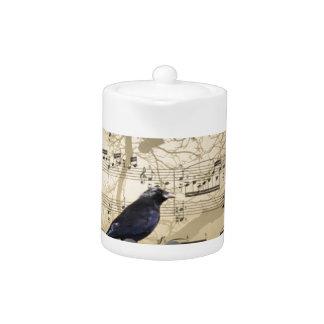 Crow on a music sheet teapot