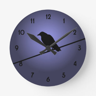 Crow on a Telephone Wire Round Wall Clocks