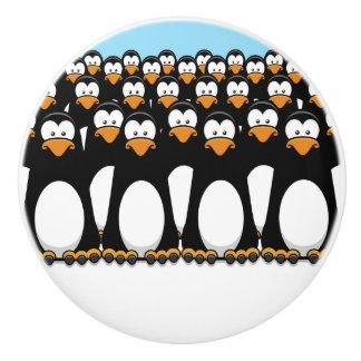 Crowd of Funny Cartoon Penguins on Snow Ceramic Knob