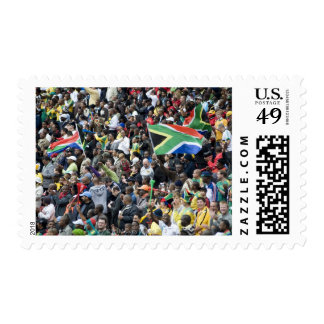 Crowd shot at a soccer game, with South African Stamp