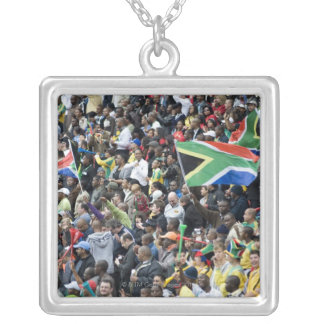 Crowd shot at a soccer game, with South African Square Pendant Necklace