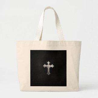 Crucifijo metálico en el cuero negro bolsa