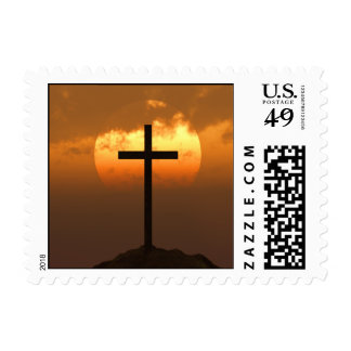 Crucifix on a Hill Against Beautiful Sunset Stamp