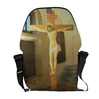 Crucifix (tempera on wood) courier bag
