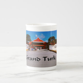 Cruise ship docked at a tropical exotic island tea cup