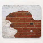crumbling old brick wall and plaster mousepads
