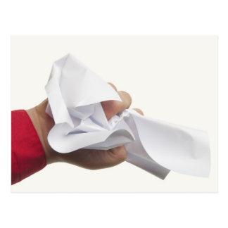 Crumpled paper in hand postcard