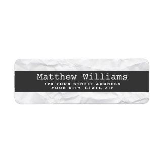Crumpled white paper texture dark gray band blank return address label