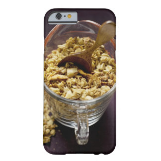 Crunchy muesli with wooden spoon in a measuring barely there iPhone 6 case