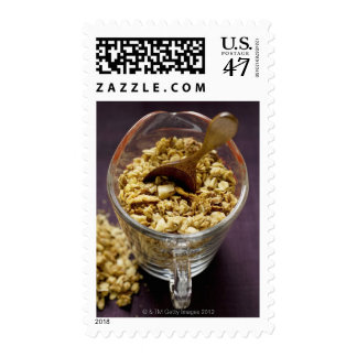 Crunchy muesli with wooden spoon in a measuring postage