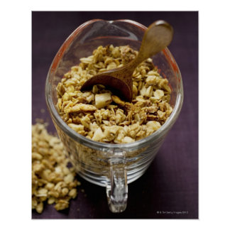 Crunchy muesli with wooden spoon in a measuring poster