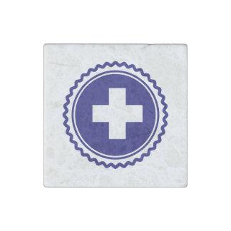 Cruz azul de la atención sanitaria del primer imán de piedra