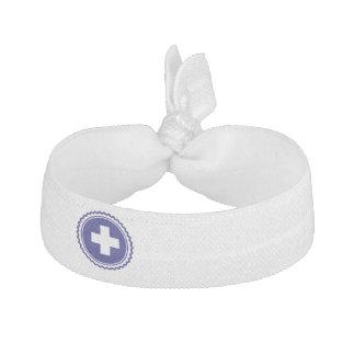 Cruz azul de la atención sanitaria del primer elásticos para el pelo