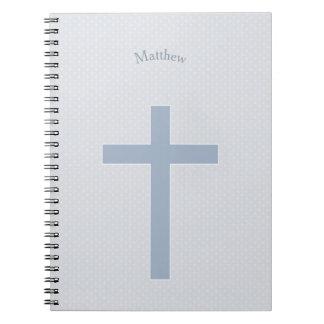 Cruz azul en colores pastel de la comunión cuaderno