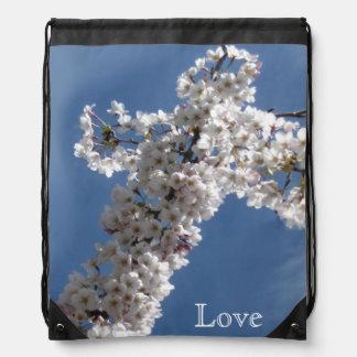Cruz blanca en AMOR del cielo azul Mochilas