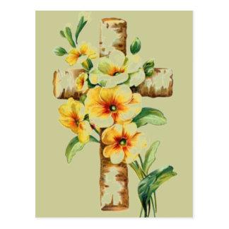 Cruz con las flores amarillas postales