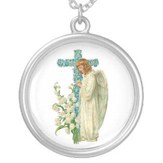 Cruz cristiana florecida azul colgante redondo