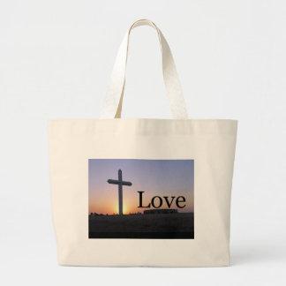 Cruz de la puesta del sol del amor bolsas