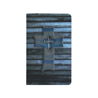 Cruz de madera azul cuaderno