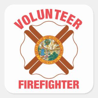 Cruz del bombero del voluntario de la bandera de pegatina cuadrada