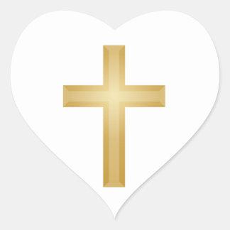 Cruz del cristiano del oro pegatina en forma de corazón
