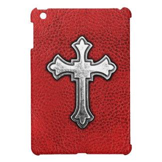 Cruz del metal en el cuero rojo