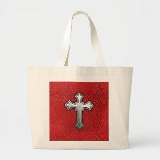 Cruz del metal en el cuero rojo bolsas